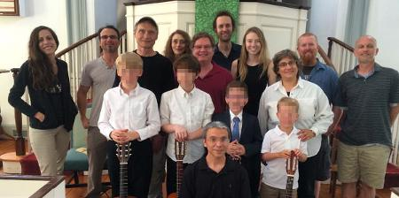 Image of 11 Suzuki Guitar Teachers and 4 kids at the Alexandria Guitar Institute