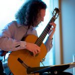 Kale Good, a Philadelphia-based guitarist, performs at a wedding reception.