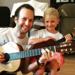 Child and teacher Kale in her Guitar Lesson