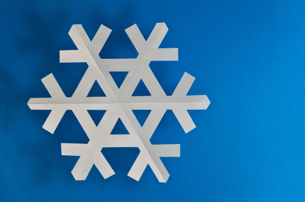 A paper snowflake that can be used to motivate children during music practice